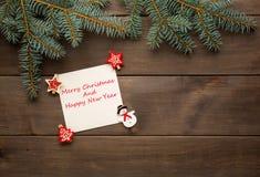 Weihnachtsdekoration auf hölzerner Hintergrundweinlese Lizenzfreie Stockfotografie