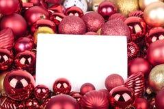 Weihnachtsdekorationen und Grußkarte stockfotos