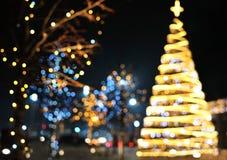 Weihnachtsdekorationshintergrund mit dem Goldenem und Blaulichtglühen stockfotografie