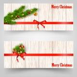 Weihnachtsdesign mit Tannenbaum auf hölzernem Hintergrund Netzfahnenschablone Auch im corel abgehobenen Betrag Stockfotografie