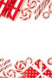 Weihnachtsdoppelte Grenze von roten und weißen Geschenken und von Süßigkeiten Lizenzfreies Stockbild