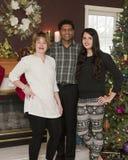 Weihnachtsdreiköpfige familie Stockbild