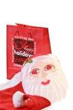 Weihnachtseinkaufen mit Weihnachtsmann-Schablone und Schutzkappe stockbild