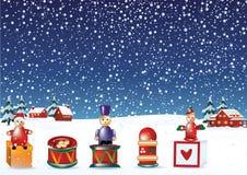Weihnachtselemente im Schnee Stockfoto