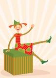 Weihnachtself, der auf einem Geschenkkasten sitzt Lizenzfreies Stockbild