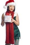 Weihnachtself-tragendes Geschenk Lizenzfreie Stockfotografie