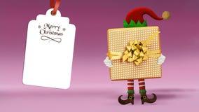 Weihnachtselfe mit einem Geschenk stockfotografie