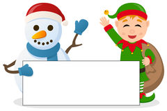 Weihnachtselfe u. -Schneemann mit Fahne Stockfotos