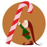 Weihnachtselfe und eine große Süßigkeit Lizenzfreie Stockbilder