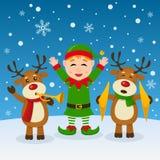Weihnachtselfe und -ren, die Musik spielen Stockbild