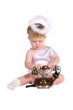 Weihnachtsengel, kleines Kind mit Telefon lizenzfreies stockbild