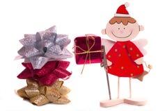 Weihnachtsengel und -bögen Stockfoto