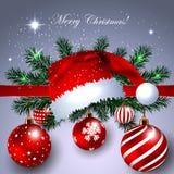 Weihnachtsfahne mit Santa Claus Hat- und Dekorations-Bällen Stockfotos