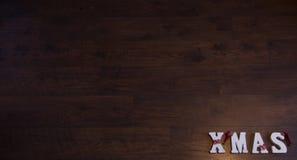 Weihnachtsfahnen-Holz-Hintergrund Stockfoto