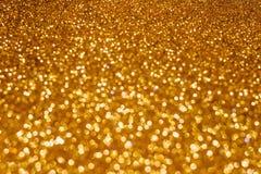 Weihnachtsfeiertagszusammenfassung bokeh Hintergrund mit Goldlichtern Funkeln bokeh Hintergrund lizenzfreie stockfotografie