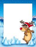 Weihnachtsfeld mit nettem Ren Stockfoto