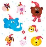 Weihnachtsfest-Tiere mit Sankt-Hüten Lizenzfreies Stockfoto