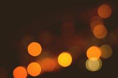Weihnachtsfestlicher abstrakter Feiertagshintergrund mit bokeh defocused Lichtern und Sternen Stockfotografie