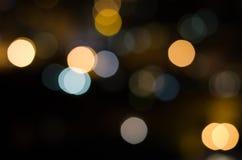 Weihnachtsfestlicher abstrakter Feiertagshintergrund mit bokeh defocused Lichtern und Sternen Lizenzfreies Stockbild
