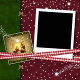 Weihnachtsfotorahmen mit Krippe Stockbilder