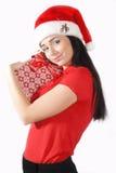 Weihnachtsfrau auf weißem Hintergrund mit einem Geschenk Lizenzfreies Stockbild