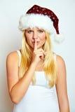 Weihnachtsfrau mit einem Geheimnis Lizenzfreies Stockfoto