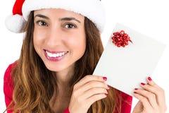 Weihnachtsfrau mit einem Gutschein Lizenzfreie Stockfotografie