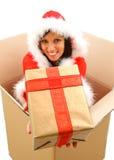 Weihnachtsfrau mit Geschenk Stockfotos
