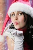 Weihnachtsfrau mit Schneeflocke stockfotografie