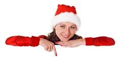 Weihnachtsfrau mit unbelegtem Zeichen Stockbild