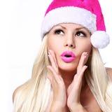 Weihnachtsfrau. Zauber überraschtes blondes Mädchen Stockfoto