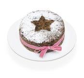 Weihnachtsfrucht-Kuchen auf einem weißen Hintergrund Lizenzfreie Stockfotografie