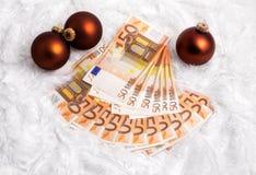 Weihnachtsgeschenk - Geld Stockfotos