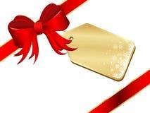 Weihnachtsgeschenk mit Bogen und Kennsatz Stockfoto