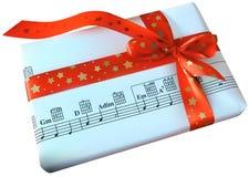 Weihnachtsgeschenk mit rotem Bogen Lizenzfreie Stockfotografie