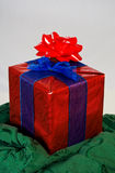 Weihnachtsgeschenk mit zwei Bögen lizenzfreie stockfotografie