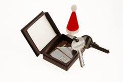 Weihnachtsgeschenk: neues Haus Lizenzfreies Stockfoto