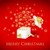 Weihnachtsgeschenkbox mit Goldband und Fliegen sno Stockfotografie