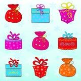 Weihnachtsgeschenke eingestellt Weiße Schneeflocken auf einem blauen Hintergrund Stockbild