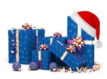 Weihnachtsgeschenke und Sankt-Hut Lizenzfreies Stockbild