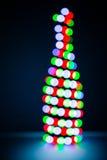 Weihnachtsgirlande als Flasche Champagner Stockbild