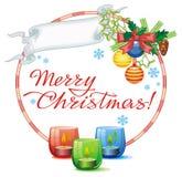 Weihnachtsgirlande, brennende Kerze und Grußtext: ` Frohe Weihnachten! ` Stockbilder