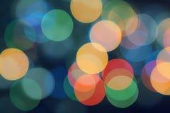 Weihnachtsgirlande - mehrfarbiges bokeh Stockbilder