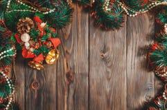 Weihnachtsgirlande mit Glocke Stockfotografie