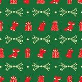 Weihnachtsglocken, Geschenke, grünes Muster der Niederlassungen stockfoto