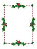 Weihnachtsgrenze mit heiligen Blättern Stockbild