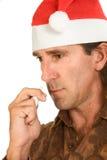 Weihnachtsgrippe - mittlerer gealterter Mann, der nasalen Spray verwendet Lizenzfreie Stockbilder