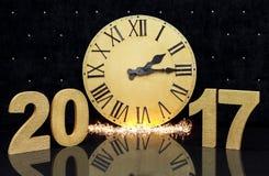 Weihnachtsgroße goldene Uhr auf schwarzem Hintergrund Zahlen neuen Jahres 2017 Lizenzfreies Stockbild