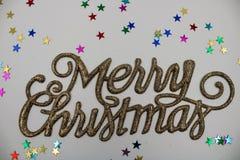 Weihnachtsgruß in der goldenen Farbe stockbilder