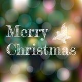 Weihnachtsgrußkarte auf Dunkelheit verwischte Hintergrund mit bokeh Effekt Lizenzfreies Stockbild